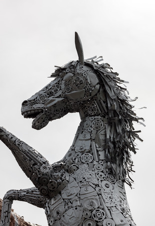 metal sculpture: Head of metal sculpture horse and blur background.