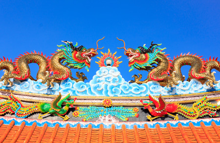 festival scales: Dragon statue on roof ,sky.This object is public in temple Thailand . Stock Photo