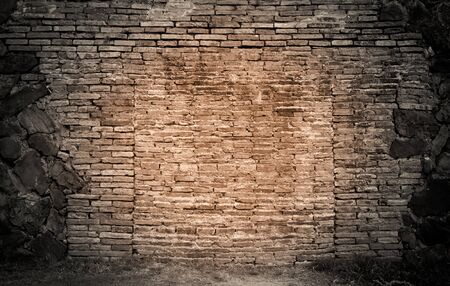 cracked wall: Brick wall,grass background by dark tone.