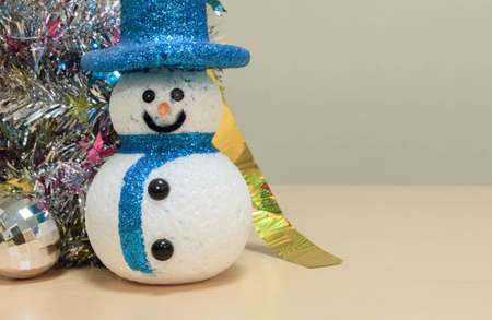snowman wood: snowman,colorful Christmas decoration on wood background.