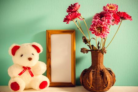 Teddy Bearpicture Frameflower In Vase On Whitegreen Wood