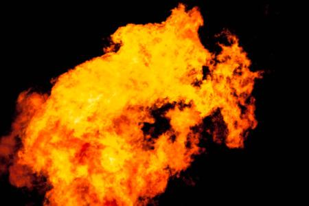 arsonist: blur background fire in night background. Stock Photo