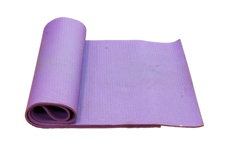 whitebackground: old purple yoga mat on white background with clipping path.