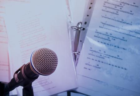 single songs: microphones on lyric background. Stock Photo