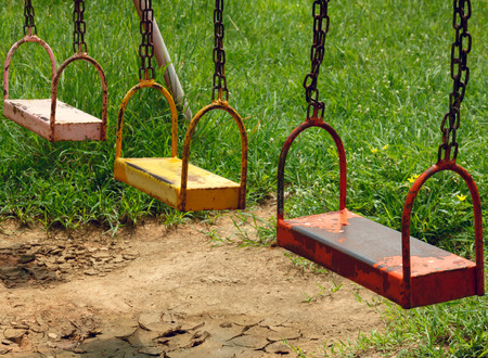playground equipment: metal swing of playground equipment at the outdoor. Stock Photo