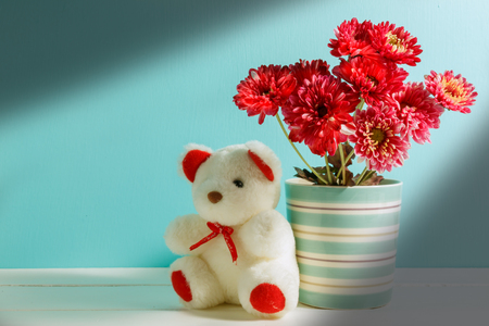 Beautiful White Teddy Bearpink Flower In Vase On Whitegreen