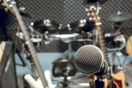 bass drum: selective focus microphone and blur musical equipment guitar ,bass, drum piano background.