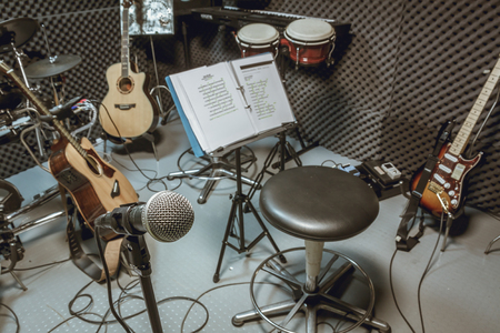 equipment: selective focus microphone and blur musical equipment guitar ,lyric, drum piano background.