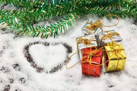 box tree: love shape, gifts box, tree on snow background.