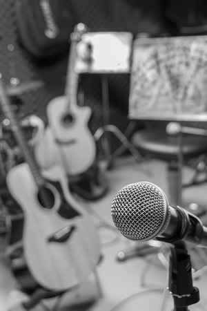 percussionist: selective focus microphone and blur musical equipment guitar ,bass, drum  lyric stand, background. Stock Photo