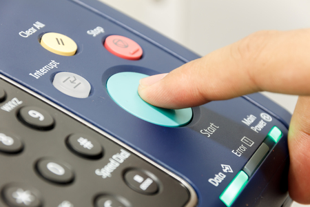 power suppliers: Fingers someone is pushing start copy machine .