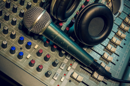 percussionist: microphone ,headphone on sound mixer background.