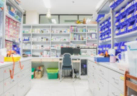 centers: blur background drug shelves in drug store. Stock Photo