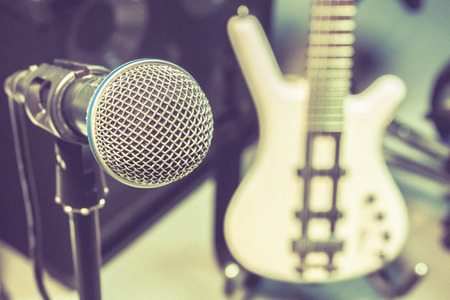 shure: microphone, blur electric bass background.