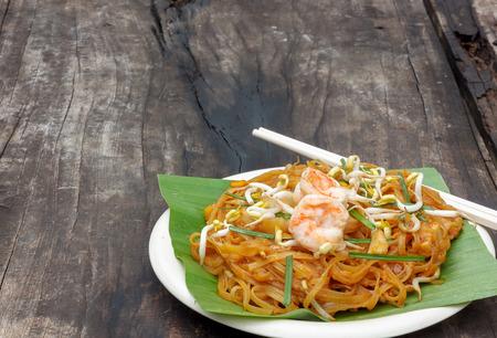 padthai: Thai noodle or padthai,garnish,vegetable,shrimp on table wood background.