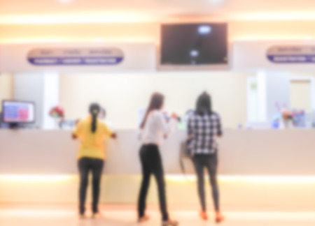 visitador medico: blur abstract background.patients are paying at the counter after treat by doctor at the hotpital.