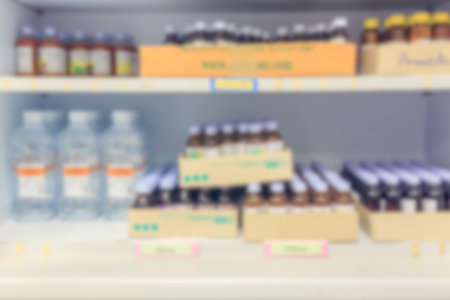 drug store: blur background drug shelves in drug store. Stock Photo