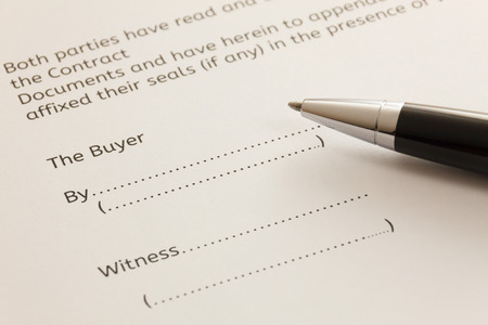 deed: selective focus pen on contract for deed form background.