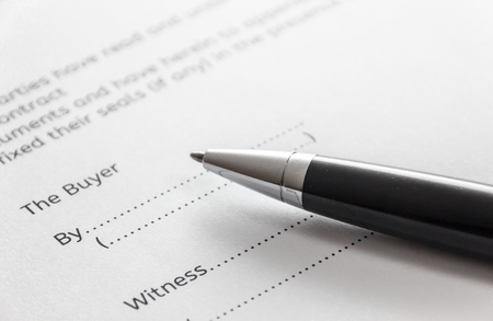 deed: selective focus pen on contract for deed form background.Contract for house buy concept.