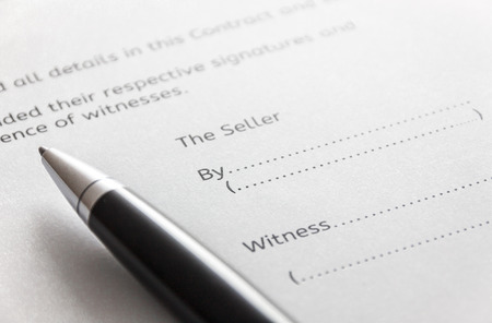 deed: selective focus pen on contract for deed form background.Contract for house sale concept.