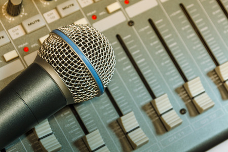 shure: microphone on sound mixer background.