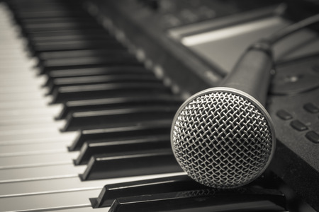 shure: microphone on piano background.