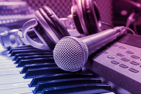 microphone,headphone on piano background. Stock Photo