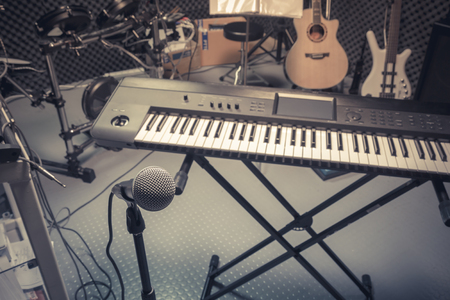 drum and bass: selective focus microphone and blur musical equipment guitar ,bass, drum piano background.