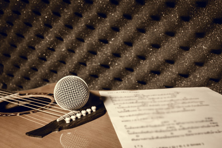 shure: microphone,lyric on classic guitar  background in home recording studio. Stock Photo