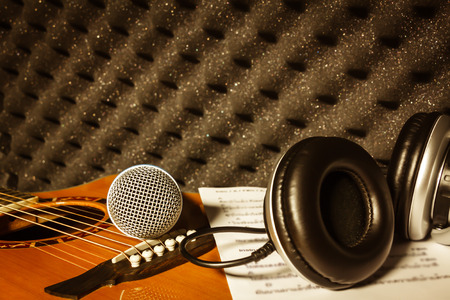 shure: microphone,headphone,lyric on classic guitar  background in home recording studio.