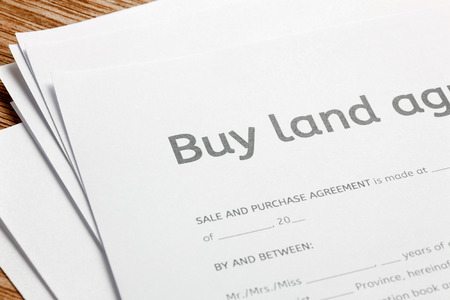 Land Contract Form On Wood Background. Stock Photo, Picture And