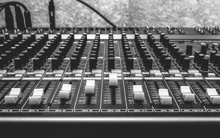 producing: selective focus the music dj concept  sound mixer musical equipment gold bokeh background. Stock Photo