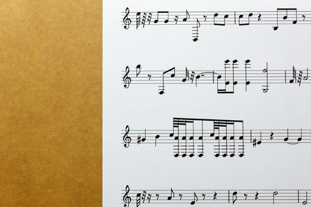 compose: Create or compose this music note paper by myself. sheets music note on brown ola paper background.