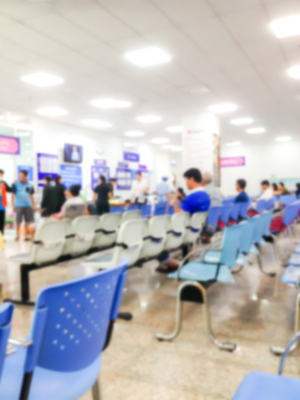 Blur background medical concept the  many patient waiting doctor for treatment in hospital. Stock Photo