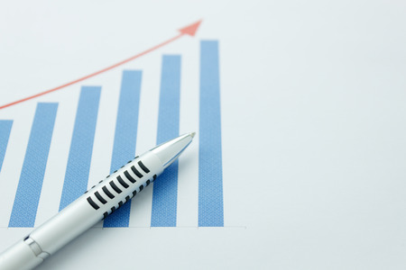 business background grown up concept the pen on business chart document background. Stock Photo