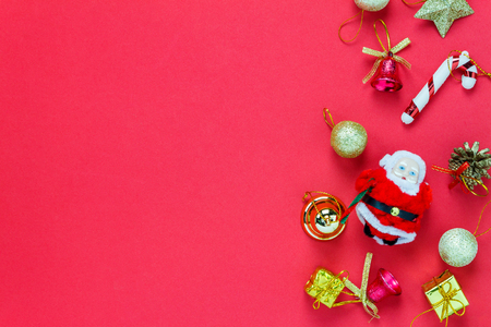 merry chrismas: Top view Christmas decoration and Santa Claus doll on red background with copy space. Stock Photo