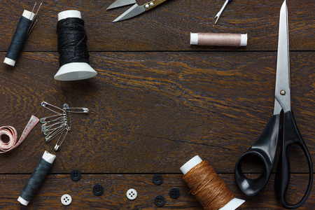 tailored: Top view tailor items on wooden background with copy space.