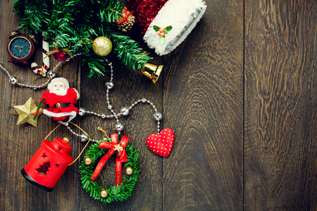 Top view Christmas   decoration,lamp and  jewelry clothesline on wooden table background with copy space.