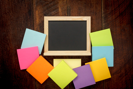 notepaper: Top view education concept the accessories back to school the black board and color ful notepaper on office desk.