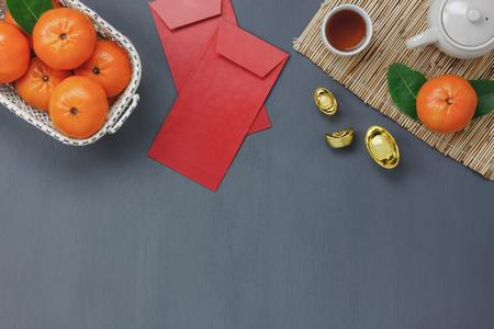 Aerial view of decoration Chinese Happy New year concept background.Essential several items for season.Mix variety on the modern grey wood office desk.Free empty space for creative design text or word