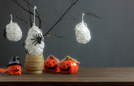 Happy Halloween decorations festival and dessert concept background.Mix variety accessories on modern design wooden at home office desk.Blur grey wood and copy space.free space for word and text.