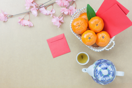 Overhead view of essential items Chinese & Lunar new year background concept.Orange and difference items for festive season.Variety objects on the modern rustic wood at home studio.Copy space design.