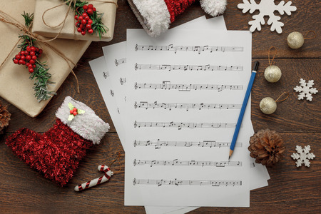 aerial view of merry christmas and music background conceptessential decorations ornament with paper