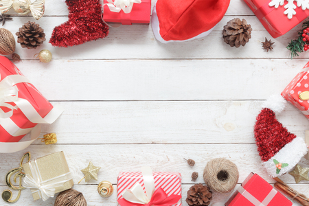 Above view of image item Merry Christmas & Happy New Year decor festival background concept.free space for creative design.Essential decorations on modern rustic white wood at home office desk studio.