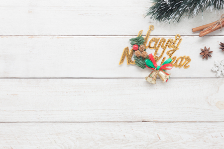Top view of decorations & ornaments Merry Christmas and Happy new year concept.Text sign season with items on the modern rustic white wooden at home office desk.space for creative text and wording.