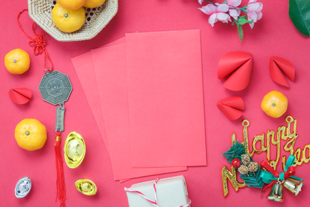 Arrangement decorations Chinese new year & lunar holiday background concept.Beautiful red envelope & ornaments DIY paper fortune cookies on modern rustic wood wallpaper at home office desk studio.