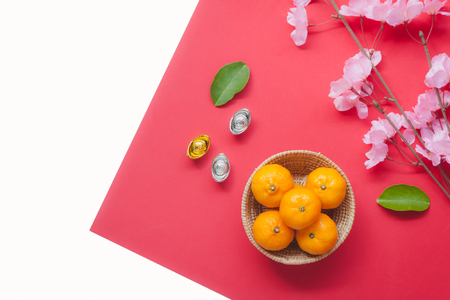 Table top view aerial of accessories and Chinese new year and Lunar new year festival concept background.Mix variety object for the season.Difference items on modern white wood at home office desk. Stock Photo