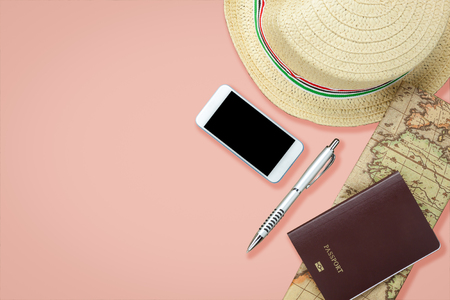 Mobile phone and passport with many item in vacation season on pink paper. Stock Photo