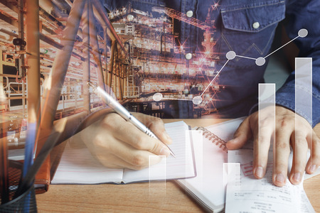 Double exposure chart growth up & financial and industrial background concept.business man working calculate payment accounting & finances on  brown office desk.Oil and gas offshore platform backdrop.