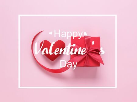 Table top view image of decoration valentines day background concept.Flat lay of red heart shape and gift box with text design backdrop on modern rustic pink paper at office desk.pastel tone.